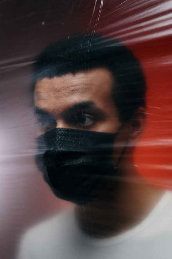 man wearing a black face mask